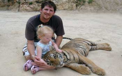 Child playing with tiger